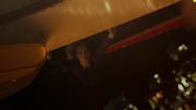 Kara hanging onto the wing of the Flight 237 plane