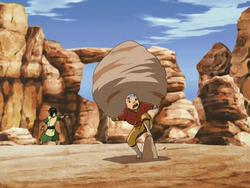 Aang carries a rock.png