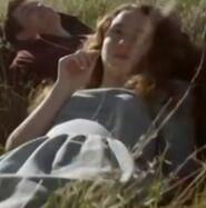 Shana Murphy as Propaganda Film Teen Couple (Scenes Deleted)