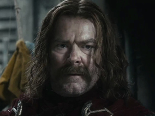 File:Mark Mitchinson as Braga (DOS).jpg