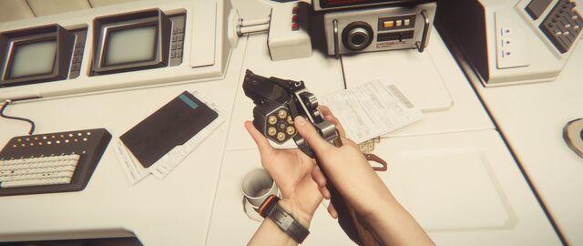 File:Ripley checking revolver's cylinder.jpg