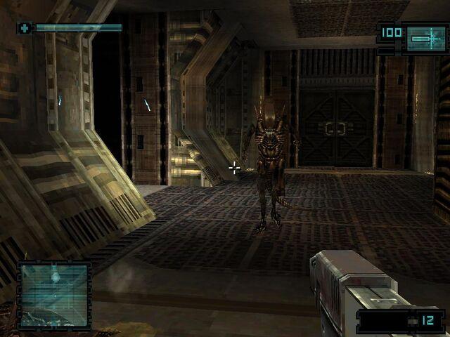 File:Using USM pistol against Alien in game.jpg