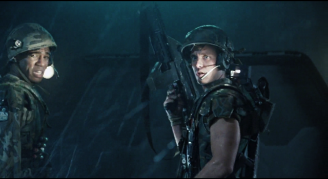 File:Hicks looks back at Ripley wearing helmet.png
