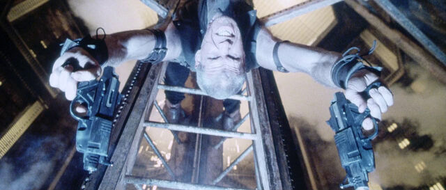 File:Johner fires pistols from ladder.jpg