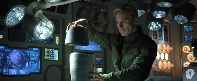 File:David examines cylinder.PNG
