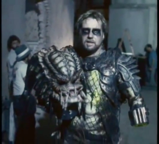 File:David Smith in Predator costume with mask off.png