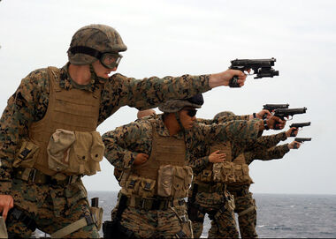 US Navy 050326-N-7526R-009 Marines assigned to 2nd Fleet Antiterrorism Security Team (FAST) Company, 3rd Platoon, fire their 9mm pistols at targets during a live fire small-arms familiarization exercise
