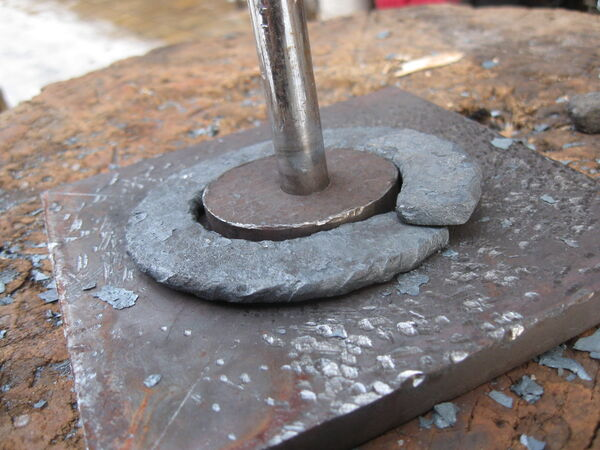 Forging field-frame rings around horizontal template - 06