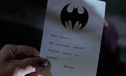 Penguin reading Batman's note