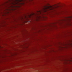 Guts submerged in blood during battle.