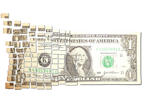 File:Torn & Cut One Dollar Note Floating Away in Small $ Pieces.jpg