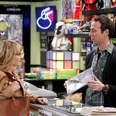 Bernadette buying a comic book from Stuart.