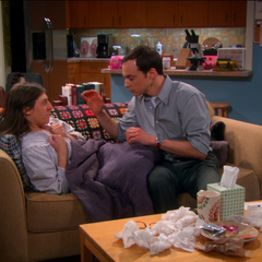 Sheldon about to rub Amy's chest.