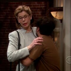 Leonard hugging his mother.