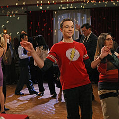 Penny dancing in the background with partner's hand on her rear, Sheldon and drunk Amy dancing in the front.