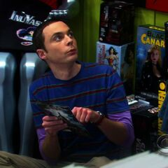 Sheldon hiding at the comic book store.