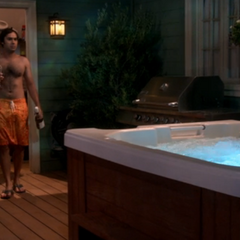 Raj using their hot tub.