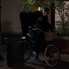 The cloak gets caught in the bike chain.