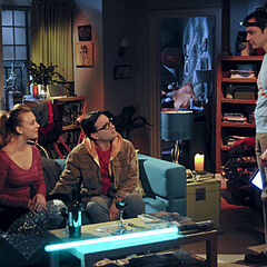 Sheldon barges into Penny's apartment during the blackout.