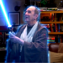 Arthur getting a kick out of his light saber.