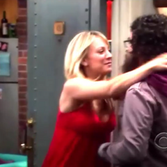 Penny attacking Leonard.