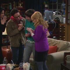 Admiring Bernadette's engagement ring.