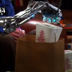Unpacking the dinner with the robotic hand.