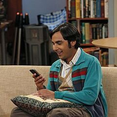 Raj on his phone.