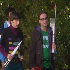 Howard and Leonard launching model rockets in the park.