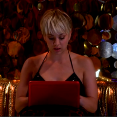 Penny studying at a strip club while watching her drunken friends.