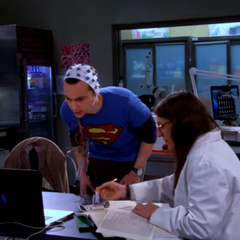 Amy helping Sheldon measuring his anxiety levels.