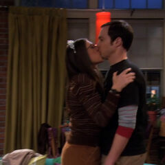 Amy kisses Sheldon to thank him for the tiara.