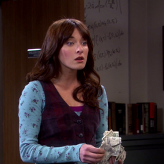 Sheldon hands her a lot of cash to get Amy a Valentine's Day gift.