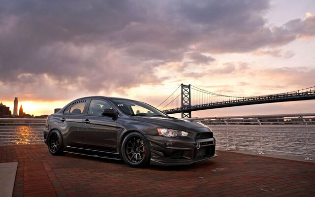File:Auto Mitsubishi Beautiful Mitsubishi Lancer Evo X against the background of the bridge 099797 .jpg