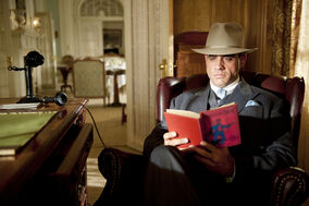 Gyp at Nucky's desk