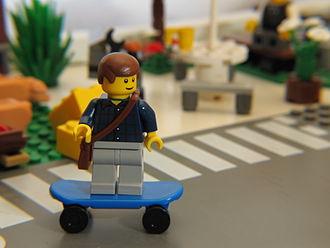 File:330px-LEGO Minifigure skating through town.jpg