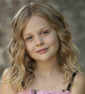 Emily-Alyn-Lind-pink-dress-headshot
