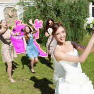 Bubblegum Troll in bride throwing bouquet