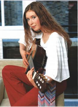 File:Hayley Westenra playing her guitar.jpg