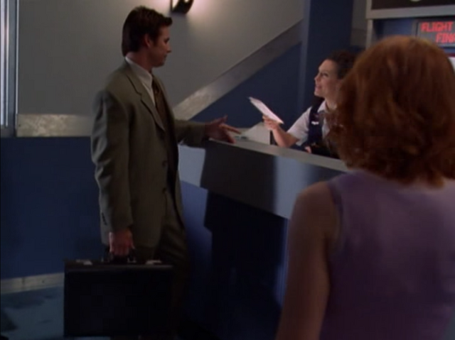 File:5x01-Ticket Agent.png
