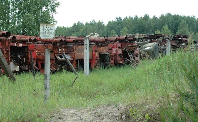 File:6x035 Chernobyl vehicle graveyard 05 going inside.jpg