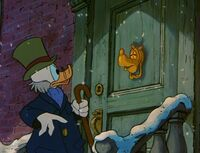 Scrooge sees Goofy on his doorknob