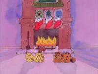 Garfield and Odie sleeping by the fireplace
