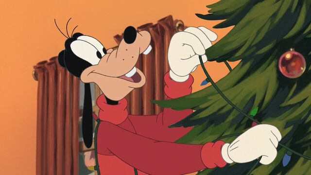 File:Goofy decorating his Christmas tree.jpg