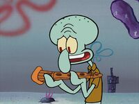 Squidward looks at his gift