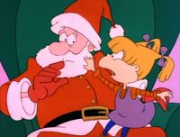Angelica pulls off Santa's beard