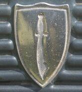 Scimitar hood badge