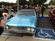Blue Oldsmobile droptop