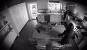 Maddie and Katie in the Bowman's kitchen - seen through the security camera