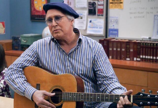 Pierce playing guitar